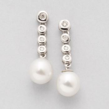 f80405931ba4 Pendientes largos en oro blanco con fila de 4 diamantes talla brillante  cada uno con un peso total de 0